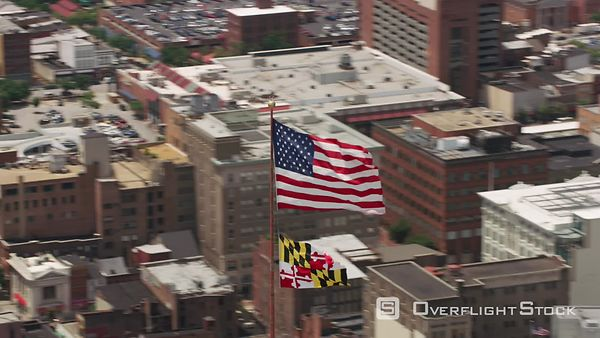Baltimore, Maryland Aerial view of US Flag and Maryland State Flag on top of Schaefer Tower.   Shot with Cineflex and RED EpicW Helium.