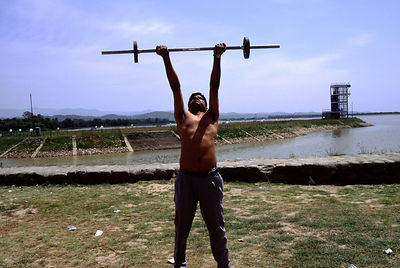 India - Chandigarh - A man lifts weights in a park