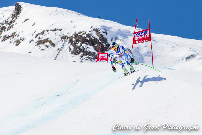 USA's Ted Ligety gets some air on his way down the downhill piste.