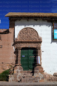 Ornate carved stone doorway of Casa de la Inquisición, Plaza de Armas, Juli, Puno Region, Peru