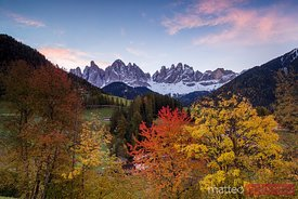 Sunrise over mountain range in Funes Valley Dolomites Italy
