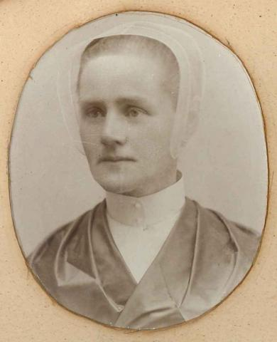 Photograph of Sister Emily Offord, in framed group of 26 portraits, Mount Lebanon, NY
