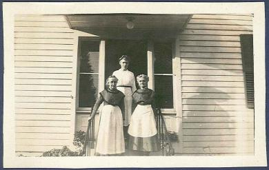 [Sisters Adeline Patterson, Mariette Estey, and Alice Braisted, in Front of the Ministry Workshop, Church Family, Hancock, MA]