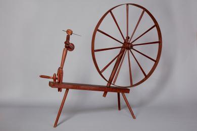 Wool spinning wheel stamped