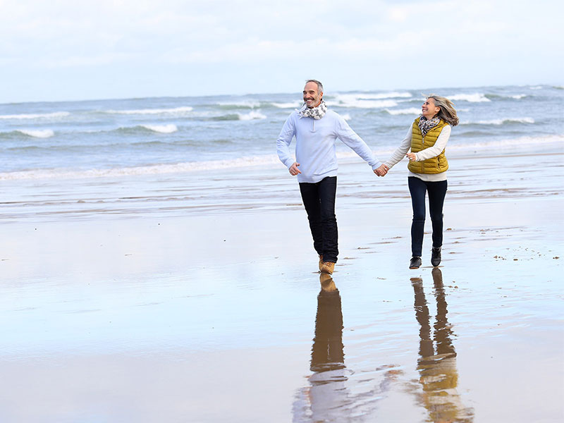 Couple on beach after Understanding Medicare Rules