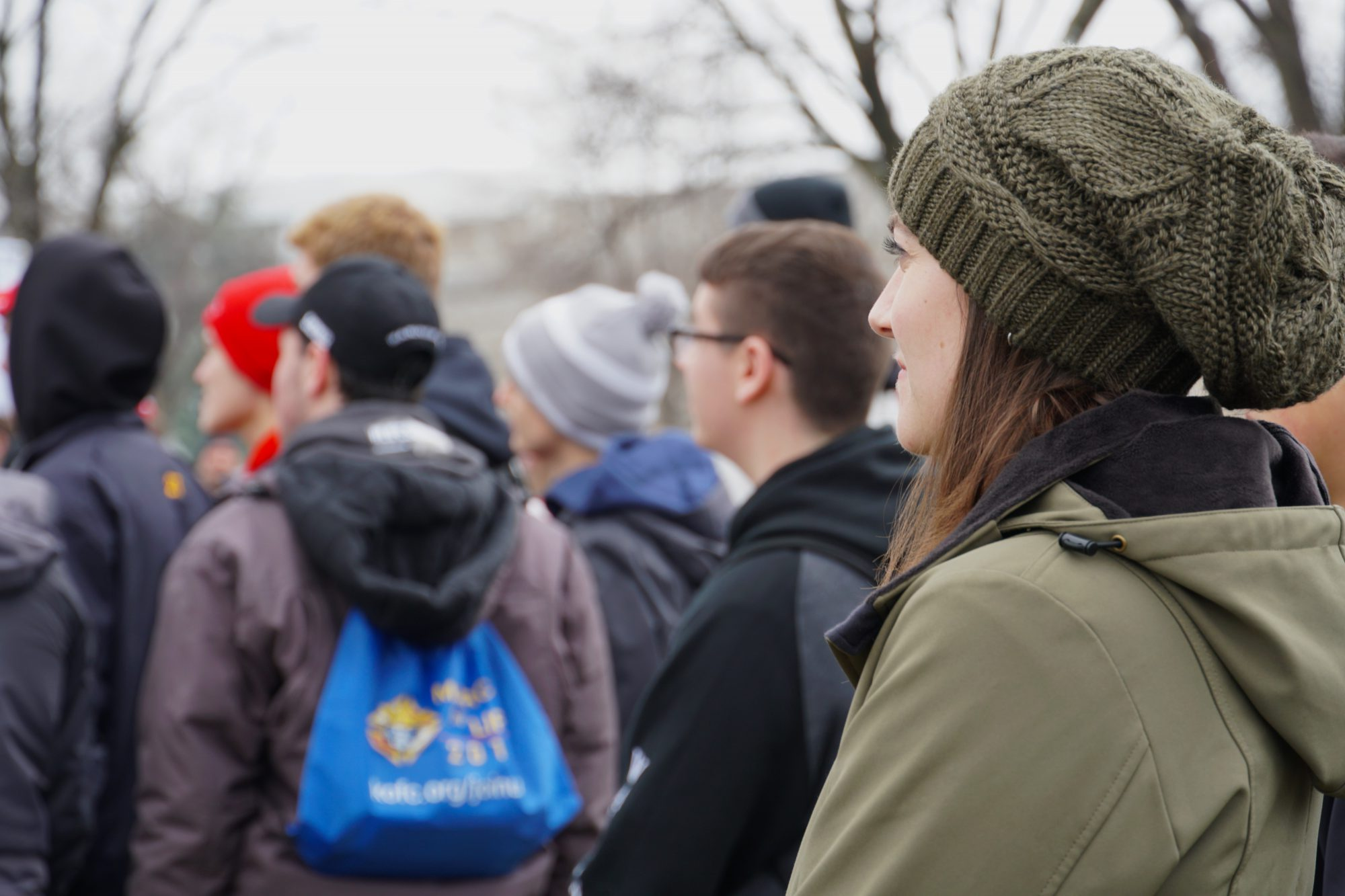 A woman listens to anti-abortion speakers at the March for Life rally. (Ester Wells/MNS)