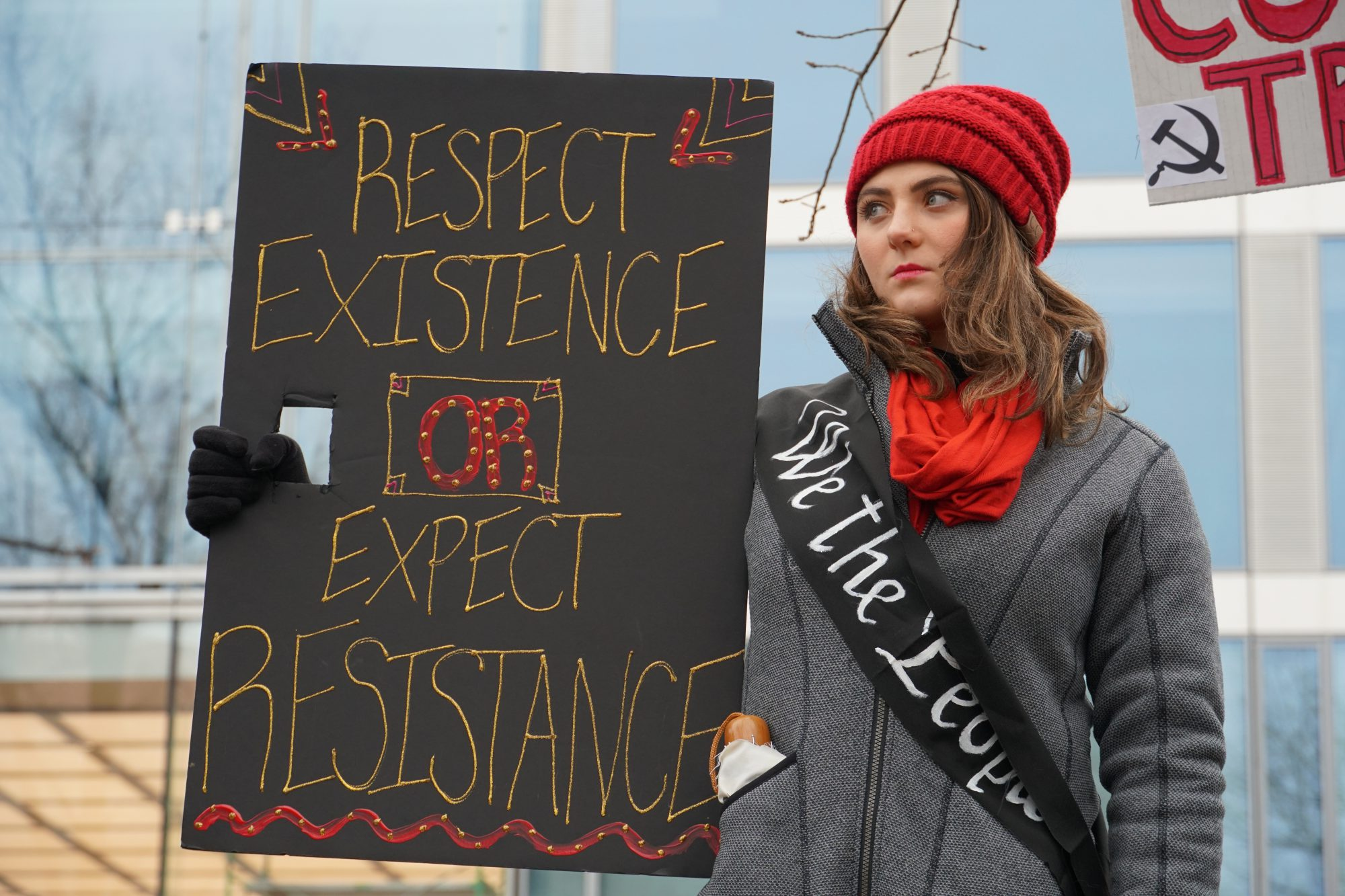 A woman holds up a sign at the Women's March rally. (Ester Wells/MNS)