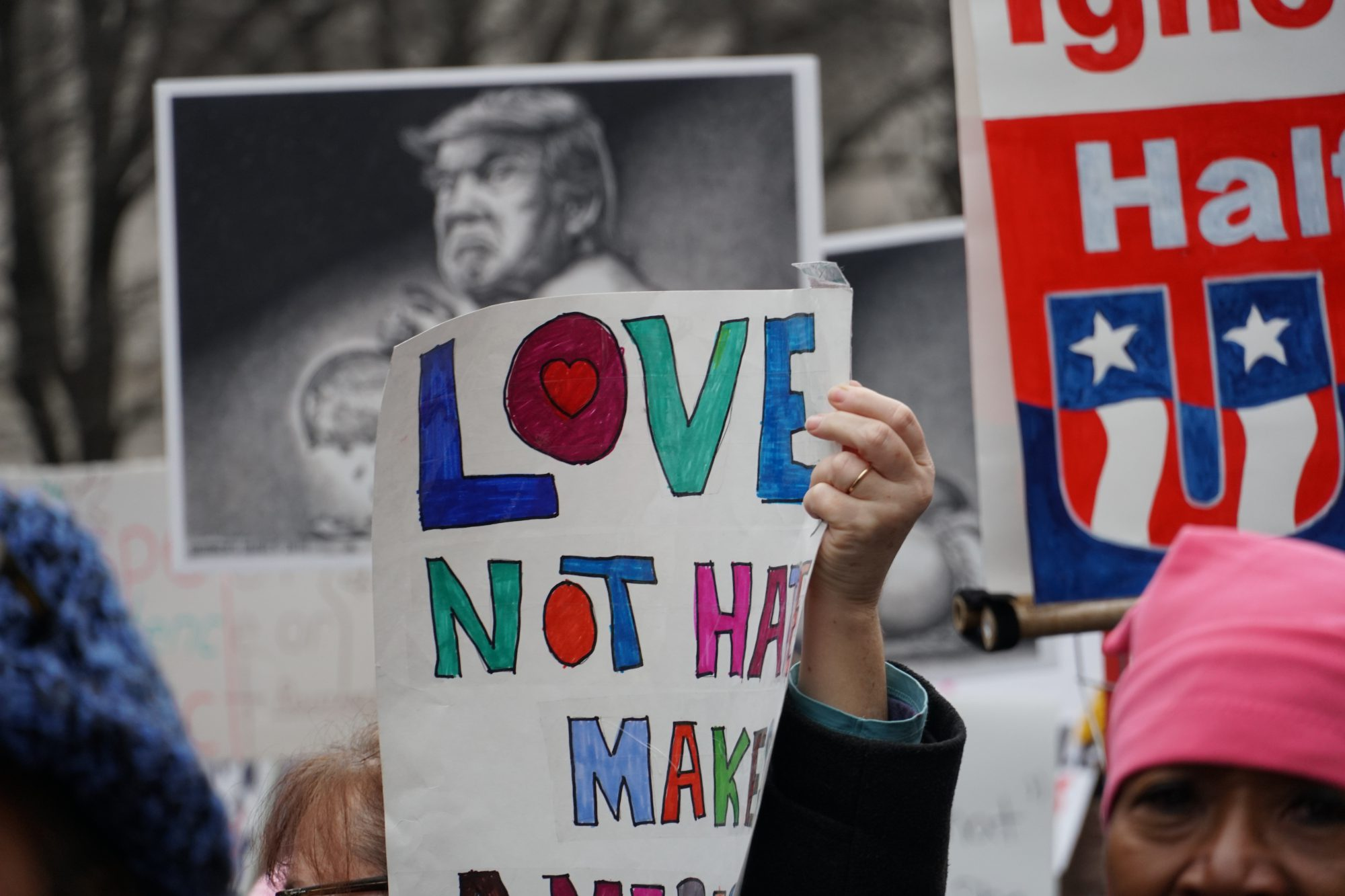 Marchers held up signs with anti-Trump and female empowerment messages. (Ester Wells/MNS)