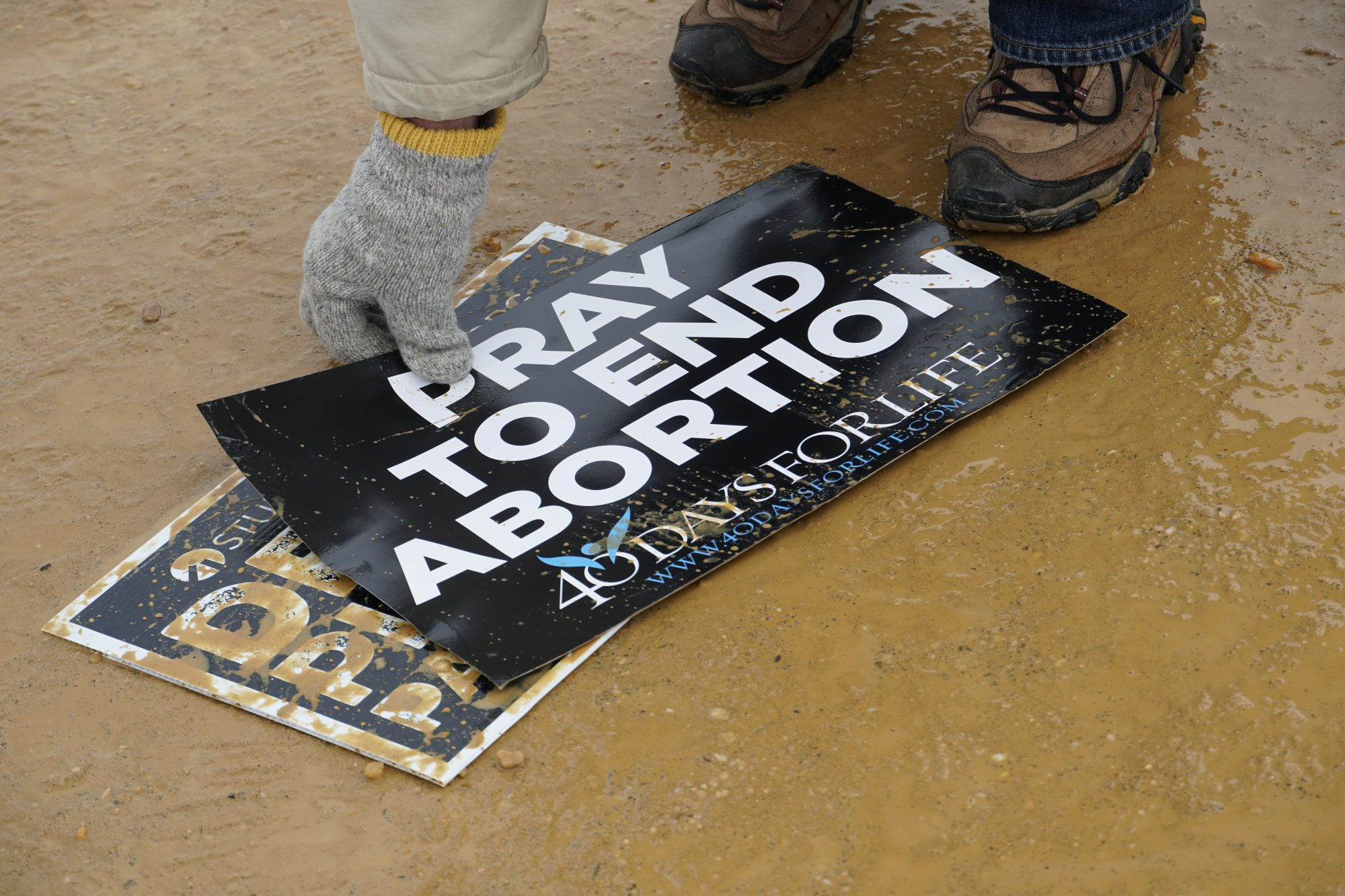 After the march, volunteers picked up anti-abortion signs that were dropped. (Ester Wells/MNS)