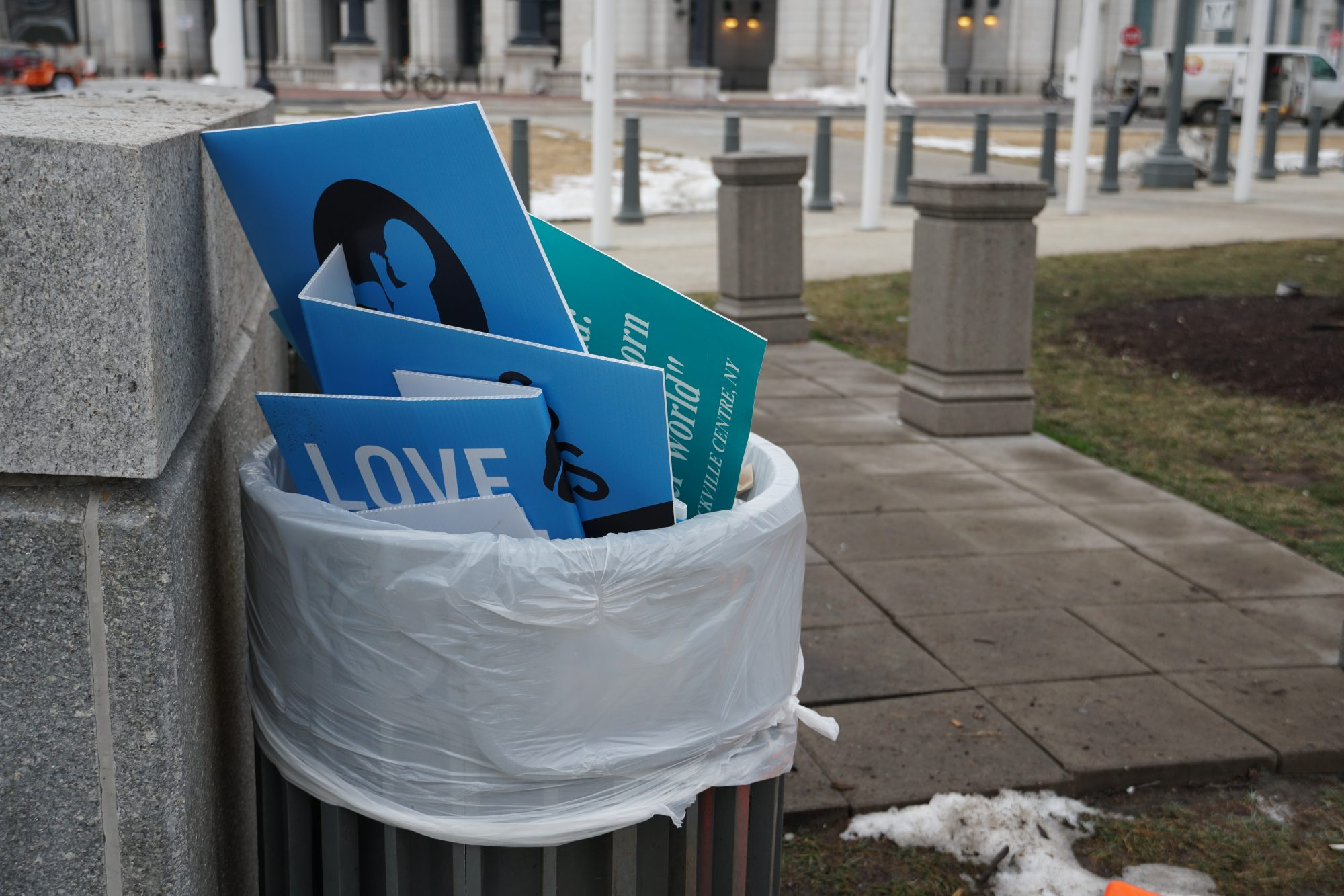Trash bins by Union Station were filled with anti-abortion signs the day after the march. (Ester Wells/MNS)