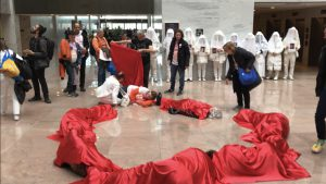 """A broken heart in Hart: After the visits to lawmakers, the group began their """"arrestable action."""" They used their bodies and red fabric to create a """"broken heart"""" on the first floor of the Hart building. (Gabrielle Bienasz/MNS)"""