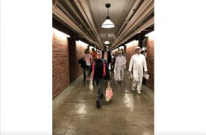 """Jeremy Tjhung and Kimberly Miller walk in in the lower floors of the Russell Senate building headed to lawmakers office to """"shame"""" lawmakers who do not support stricter gun laws and to deliver thank-you Valentines to the ones who do. (Gabrielle Bienasz/MNS)"""