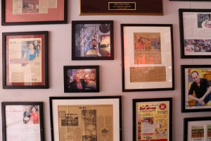 Newspaper clippings about the diner and pictures of famous visitors hang along the walls. (Charlotte Walsh/MNS)