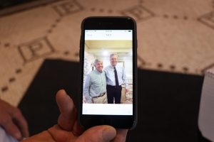 Pappas displays a picture of himself and Jeb Bush after a visit to the restaurant during the 2016 election. (Charlotte Walsh/MNS)