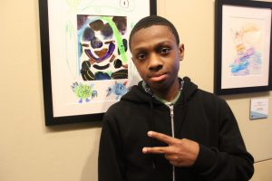 Malik Claiborne, 11, is a local DC student who rapped at the opening of the exhibit as a featured performer and talked about his love for art. (Nirmal Mulaikal/MNS)