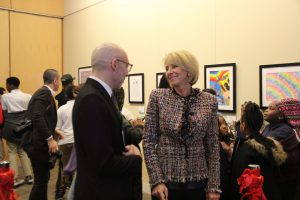 Education Secretary Betsy DeVos and Mario Rossero, senior vice president of education at The Kennedy Center, talk during the opening the of the exhibit. (Nirmal Mulaikal/MNS)
