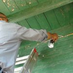 Worker doing air sealing for an energy efficiency project