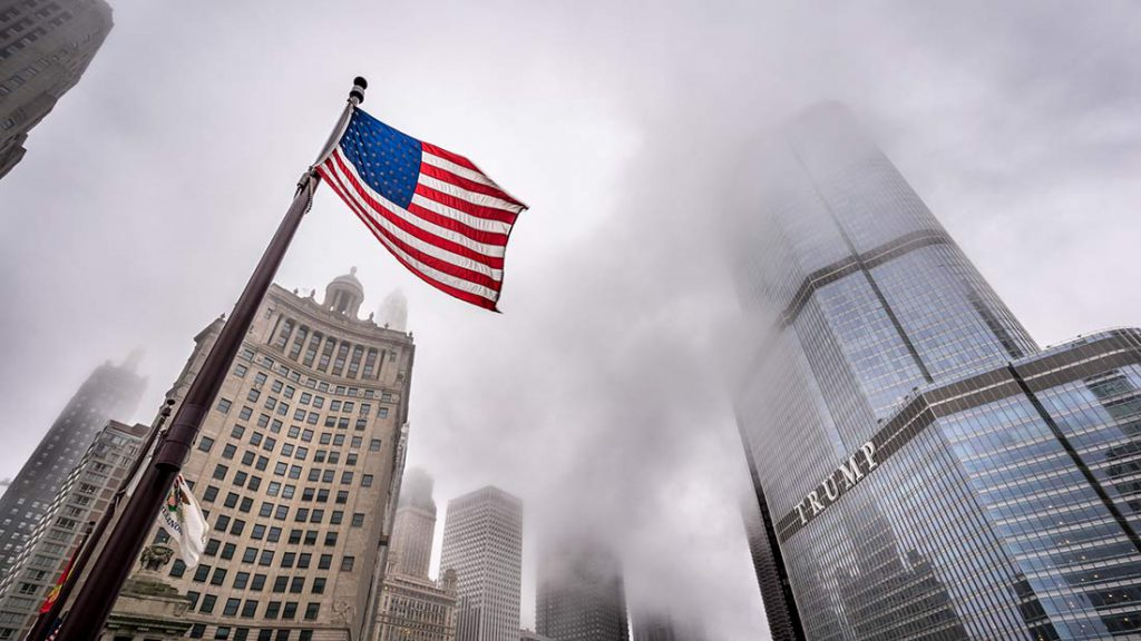 American flag and downtown Chicago skyline by Trump Tower