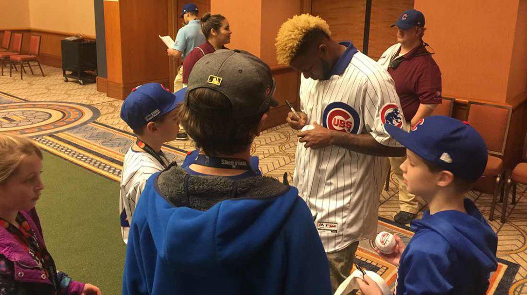 Pitcher Jose Rosario signs autographs