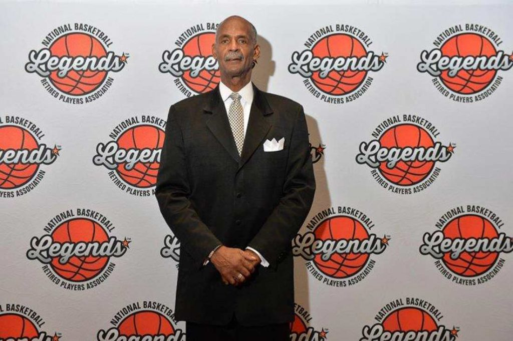 La Rue Martin poses for a photo at a National Basketball Retired Players Association event.