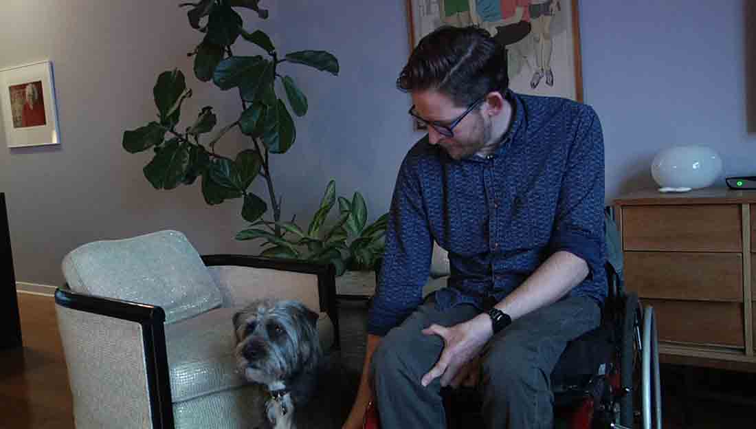 Aaron Anderson with his dog Buddy in his Uptown apartment.