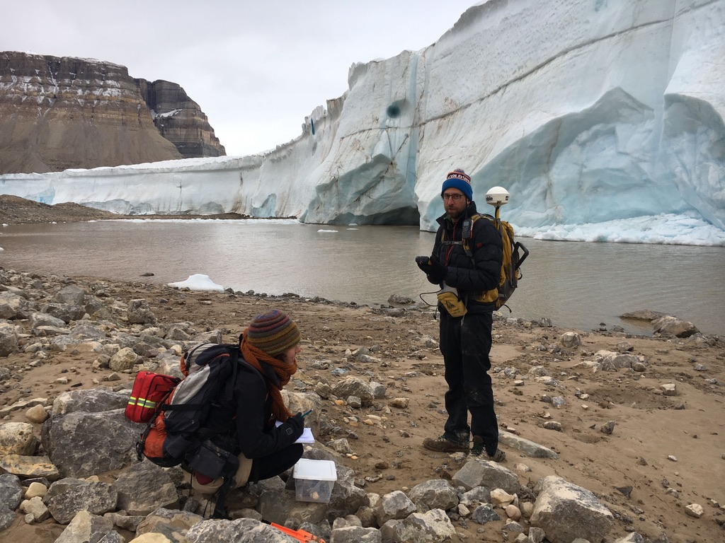 Paleoclimatologist Brendan Reilly and PhD student Anna Glueder collect rock and sediment samples near the Petermann Glacier in northwest Greenland. (Brendan Reilly/Oregon State University)