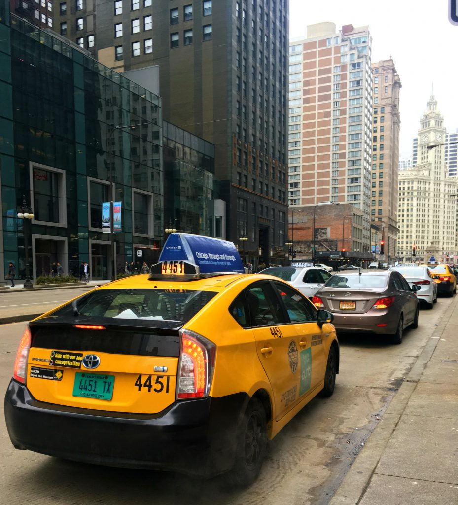 Taxi driver waits on Michigan Avenue (Kari McMahon/Medill)