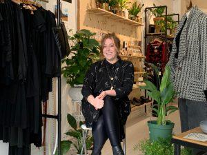 Merl Kinzie sitting in her shop, The Shudio.