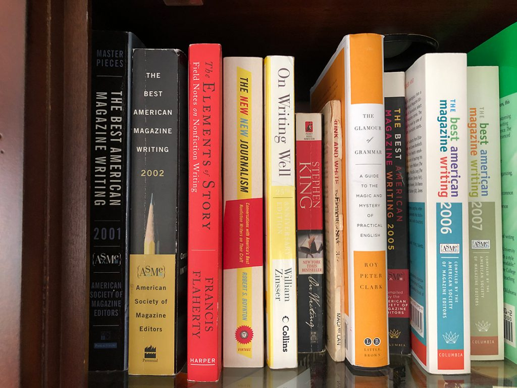 Books on writing and journalism on a shelf