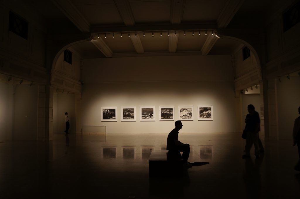 man in art gallery
