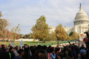 """By 1 p.m., students marched towards the west front of the Capitol.  Students from Schools Without Borders shouted, """"Love trumps hate."""""""