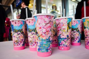 Cups adorned with artwork by Maggie O'Neill, the festival's official artist, were given away to attendees. (Rhytha Zahid Hejaze/MNS)