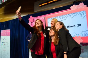 National Cherry Blossom Festival staff members take selfies onstage after the press conference. (Rhytha Zahid Hejaze/MNS)