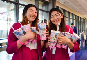 The Goodwill Ambassadors from National Cherry Blossom Festival hold cups to give away to attendees. (Rhytha Zahid Hejaze/MNS)