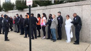 The arrested members of GAG who wait to load into the police van outside of Hart Senate Office Building. (Gabrielle Bienasz/MNS)