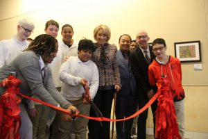 DeVos stands with Rossero, Borrayo, and other students at the ribbon-cutting ceremony. (Nirmal Mulaikal/MNS)