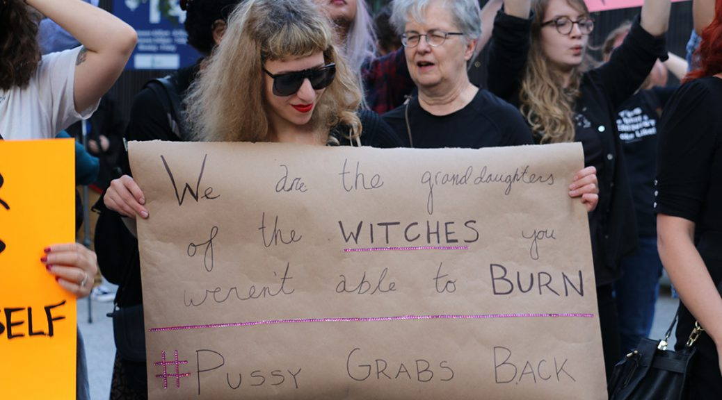 Nina Berman holds a sign at the #GOPHandsOffMe rally in October (Anna Foley/MEDILL).
