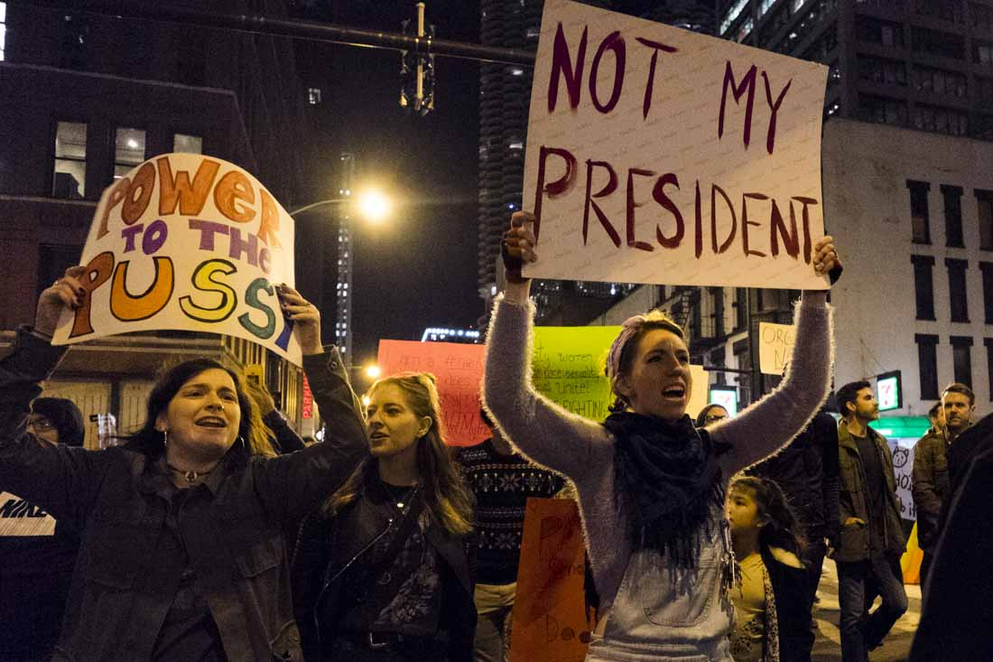 """Protester with """"not my president"""" sign"""