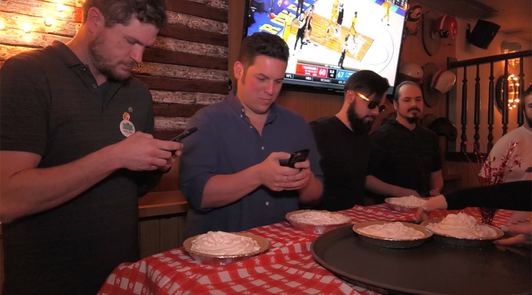 Pie-eating contestants prepare to eat four pounds of whipped cream