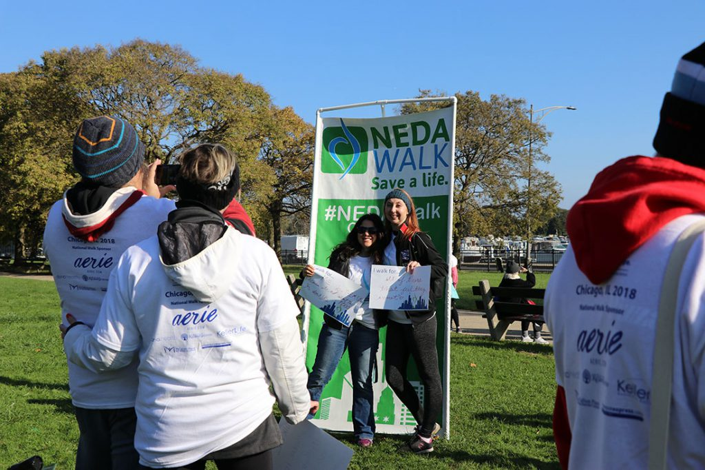 """NEDA hopes that the community and support continues after the walk. """"We can't just come to this walk and then the conversation is finished,"""" Lawrence said. """"I want you to remember to speak up as much as you can and as much as you are able to while still protecting yourself. This isn't just a conversation to be had today. Eating disorders don't discriminate. They can happen to anyone at any age. We have to talk about it to remove the stigma to enable people to feel like they can seek help and that there is hope."""" (Colleen Zewe/MEDILL)"""