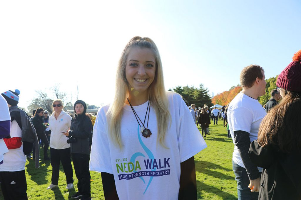 """""""A lot of people don't understand eating disorders,"""" said Cami Blechschmidt, an after-school teacher in Chicago. Now 22, she said eating disorders have affected her education, career and relationships since she was 14. """"There' a lot of stigma around eating disorders and mental health in general. The walk provides a community for people who are struggling with an eating disorder."""" (Colleen Zewe/MEDILL)"""