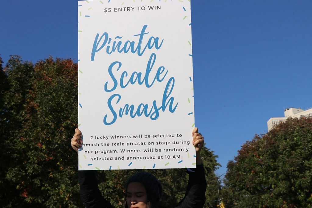 """The walk featured a """"smash the scale"""" pinata event, where participants could destroy a symbolic pinata scale. (Colleen Zewe/MEDILL)"""