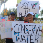 Marchers of all ages took to the streets near Guam's capital. Kristan Finney, a mother of two and legal counsel to the Guam Environmental Protection Agency, said it was her daughters, Marianne, 9, and London, 6, who pushed her to attend the march after attending it last year. Finney wants the island to work toward reducing its waste and increasing its recycling and composting services.