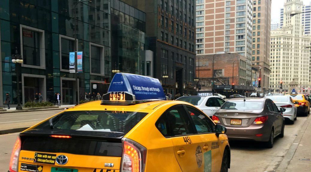 Taxi driver waits on Michigan Avenue (Kari McMahon/Medill)