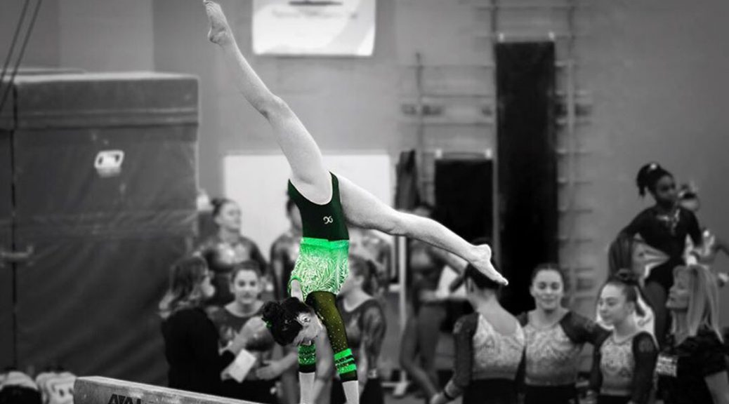 Elli Brownfield performs on the balance beam.