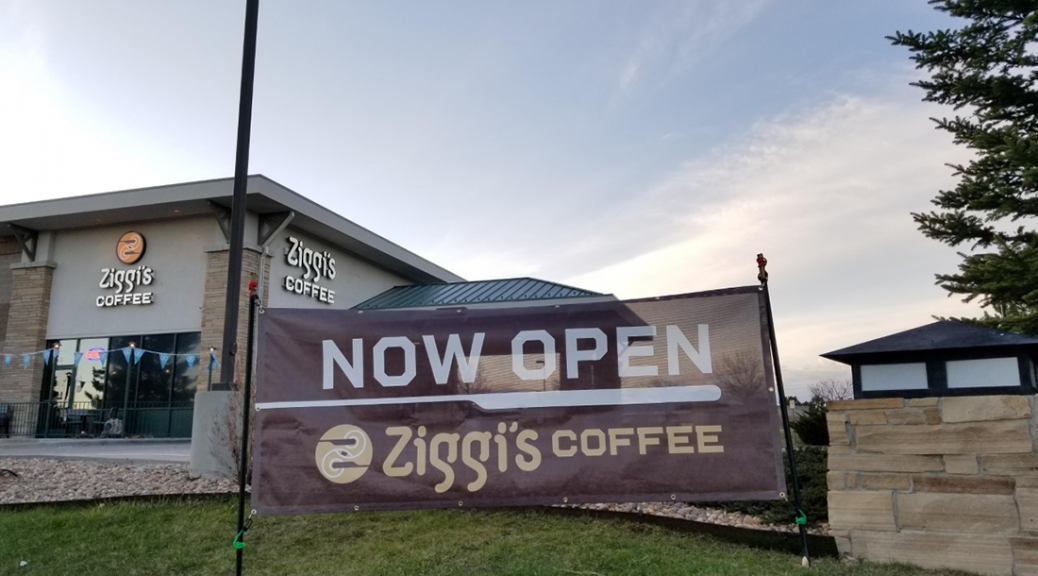 """A Sign Reads """"Now Open"""" as Ziggi's just hosted its garnd opening day on April 27, 2020"""