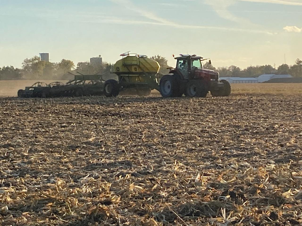 Ross Wilken seeds rye on Janie's Farm.