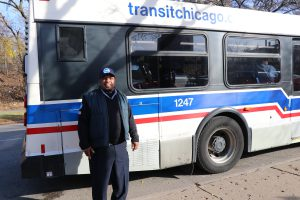 Cedric Trice stands in front of his bus at the intersection of South Lake Park Avenue and Hyde Park Boulevard. (Kelly Milan/Medill Reports)