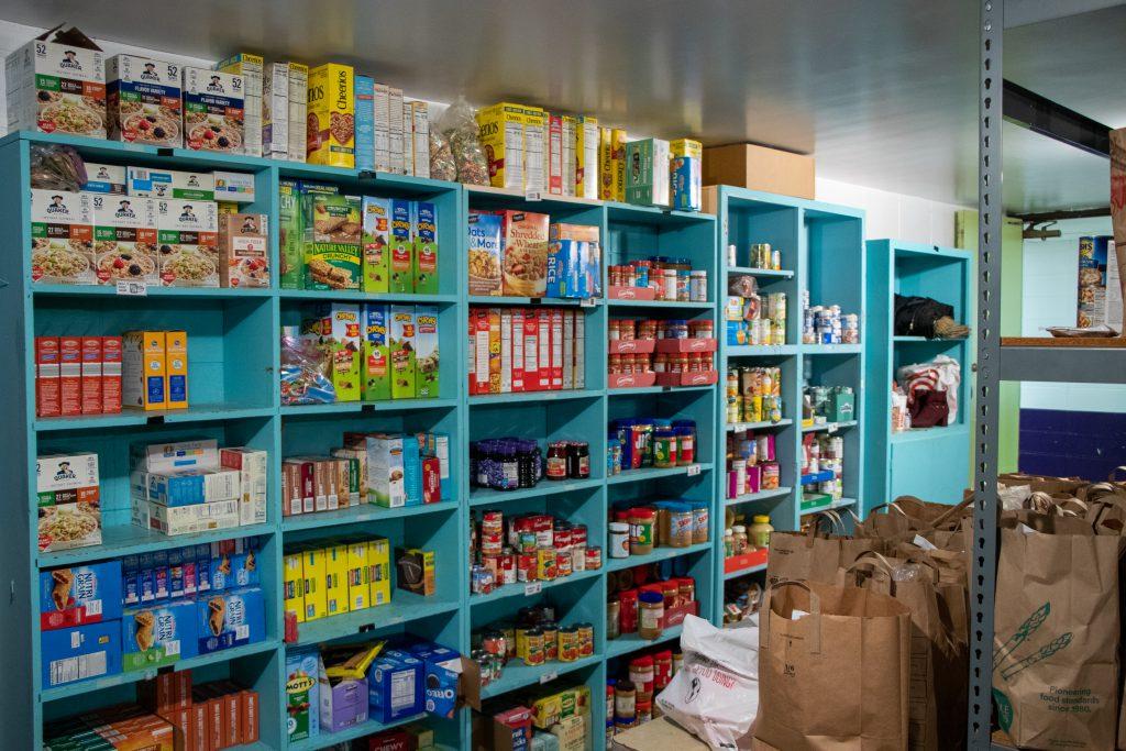 Stocked shelves in The Giving Storeroom