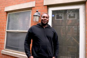 Keith Rodgers stands in front of his CHA-subsidized home.